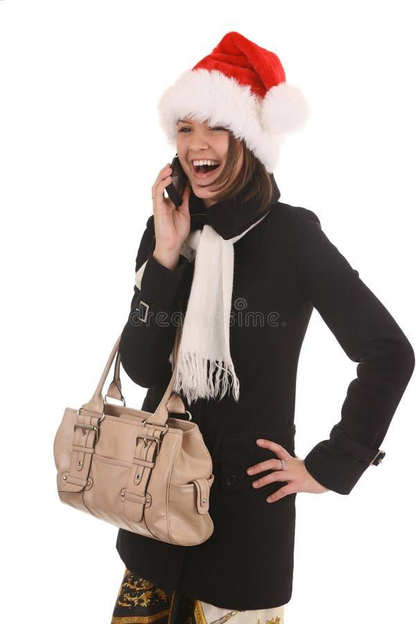 Fille de Noël avec le téléphone portable images libres de droits