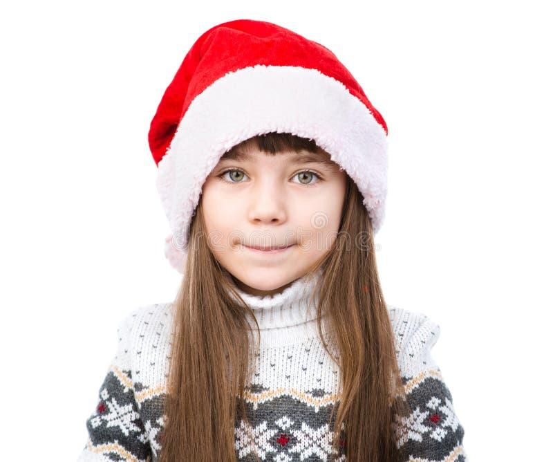 Fille de Noël de portrait dans le chapeau rouge de Santa D'isolement sur le blanc images libres de droits