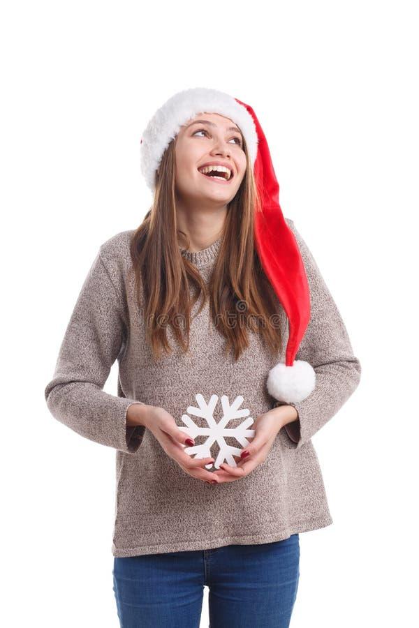 Fille de Noël heureux utilisant un chapeau de Santa d'isolement sur un fond blanc Concept de vacances image libre de droits