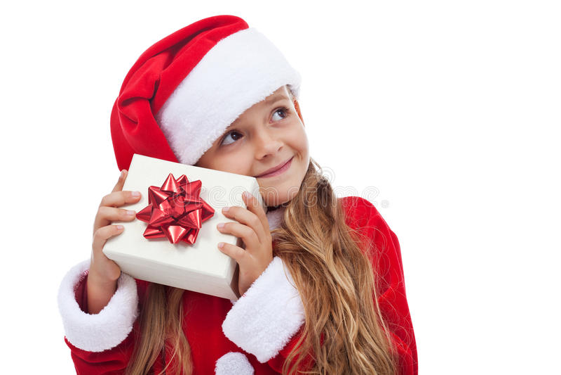 Fille de Noël heureux vérifiant le présent photos libres de droits