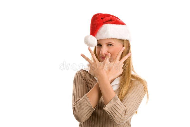 Fille de Noël indiquant le signe de victoire images stock