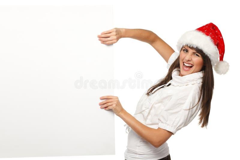 Fille de Noël tirant le panneau-réclame photo libre de droits