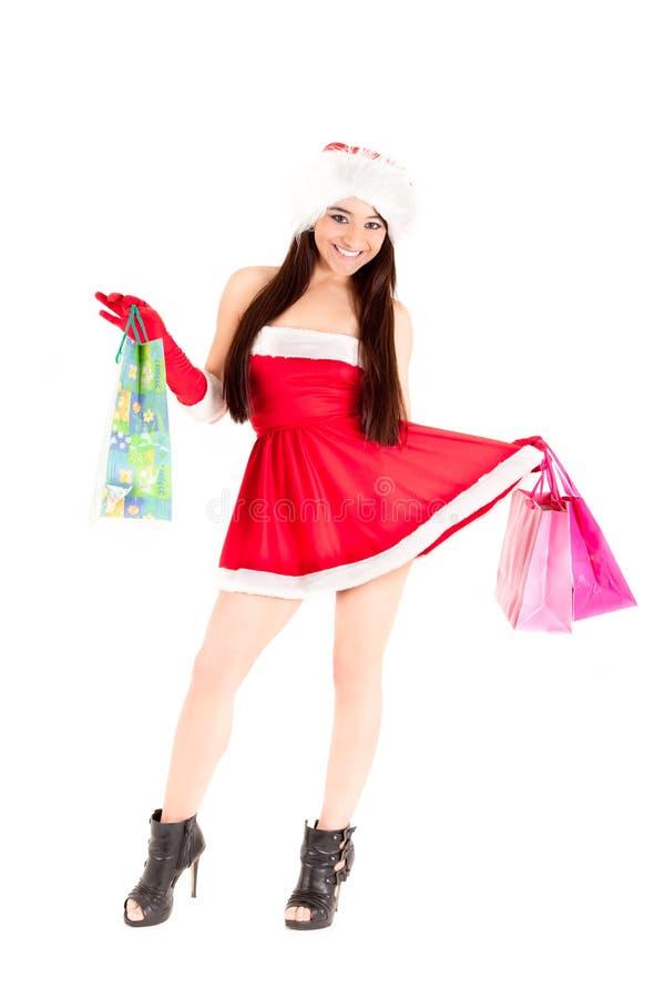 Fille de Santa avec des sacs à provisions photo libre de droits