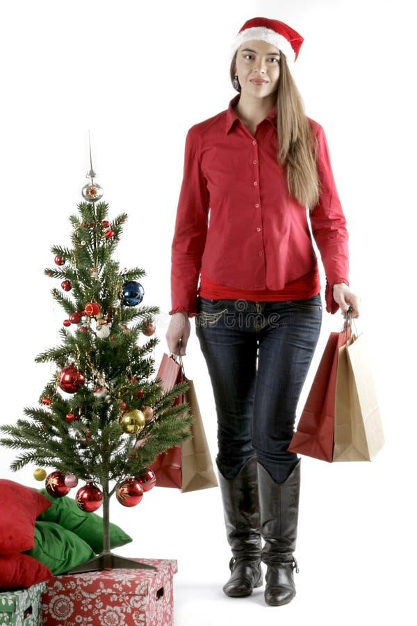 Fille de Santa avec l'arbre de Noël photos stock