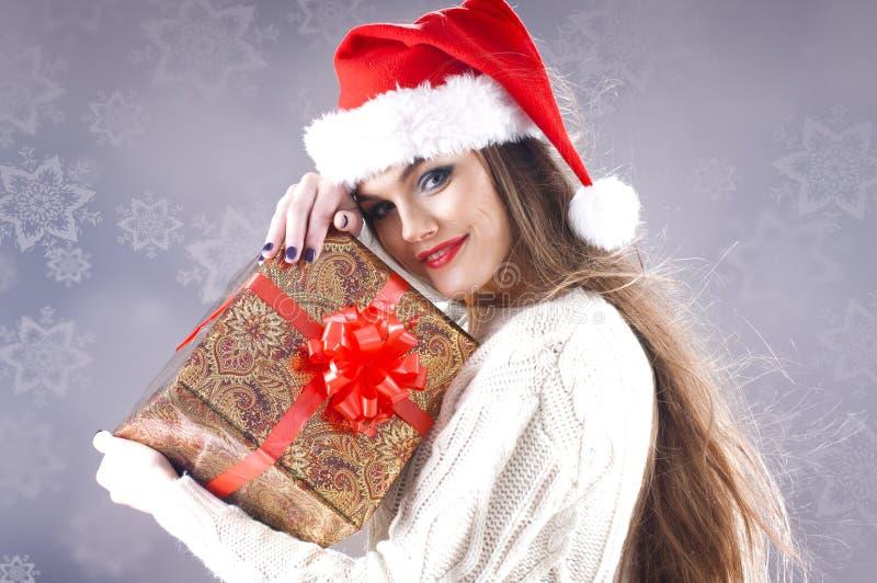 Fille de Santa avec le cadre de cadeau photographie stock