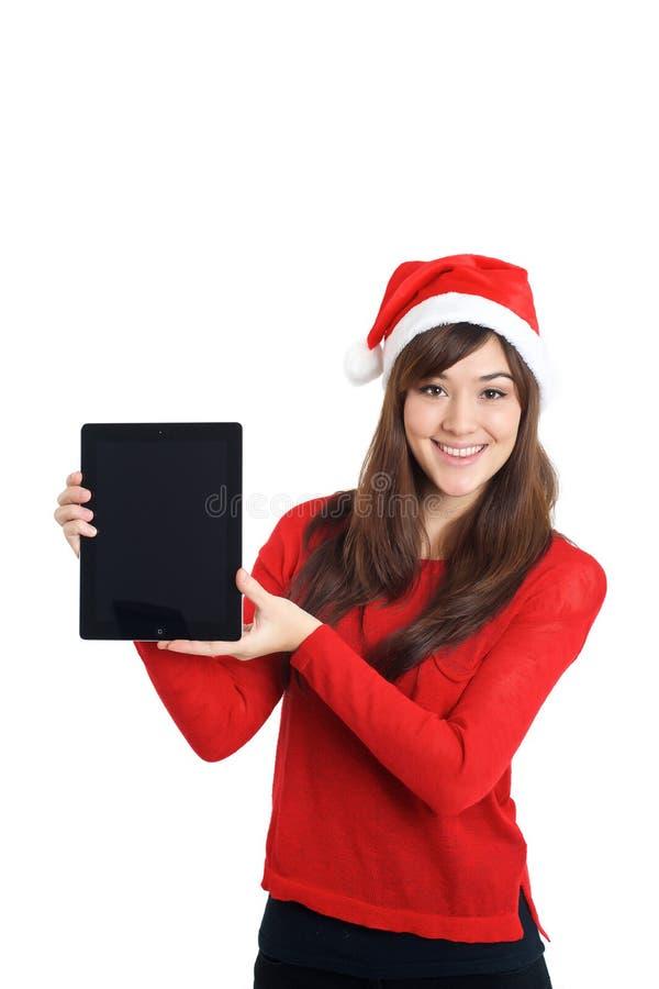 Fille de Santa Claus Christmas Asian tenant le comprimé photographie stock