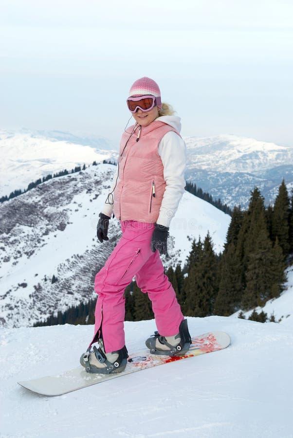 Fille de Snowboard avant en descendant photos libres de droits