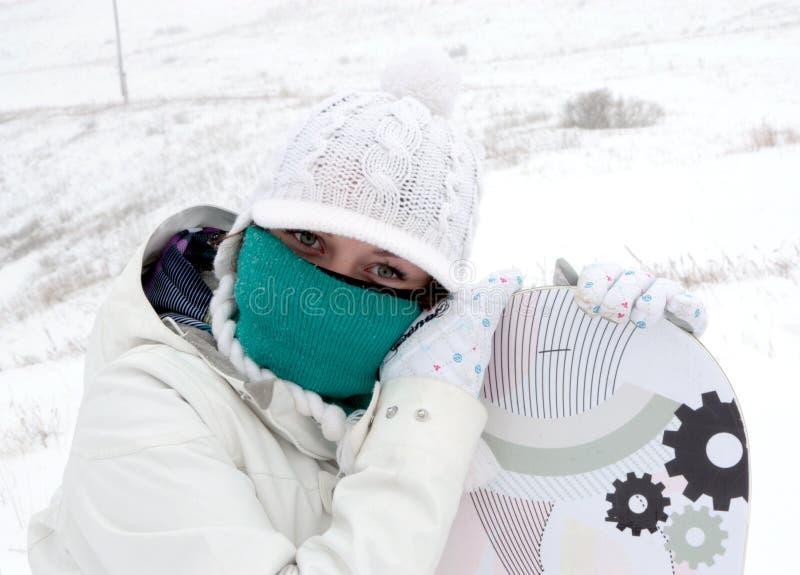 Fille de Snowboarder photographie stock libre de droits