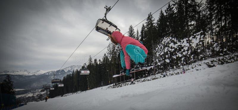 Fille de snowboarding photo libre de droits