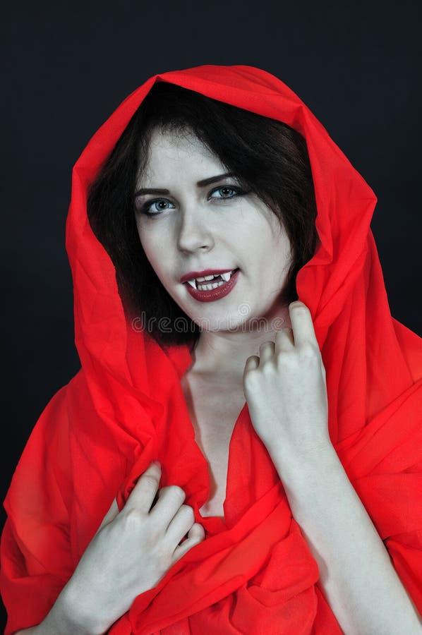 Fille de vampire dans le studio photographie stock