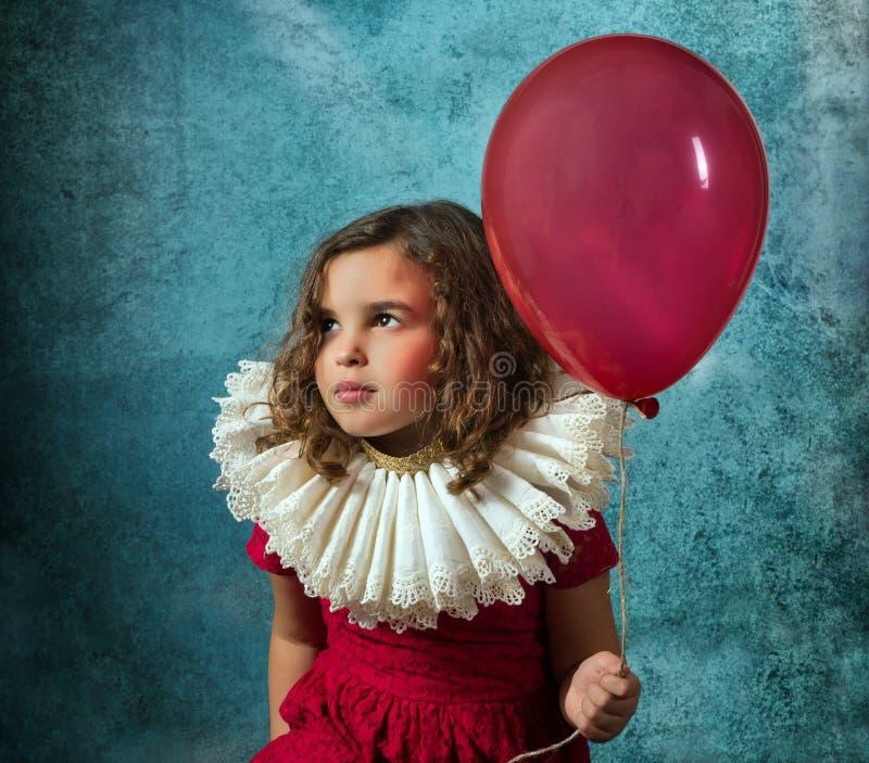 Fille de vintage avec le ballon photo libre de droits
