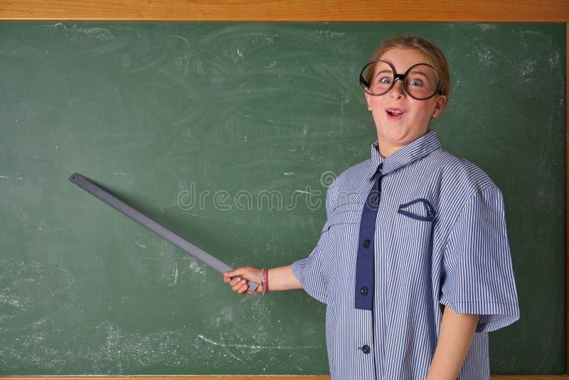 Fille drôle d'enfant au costume de maître d'école image stock