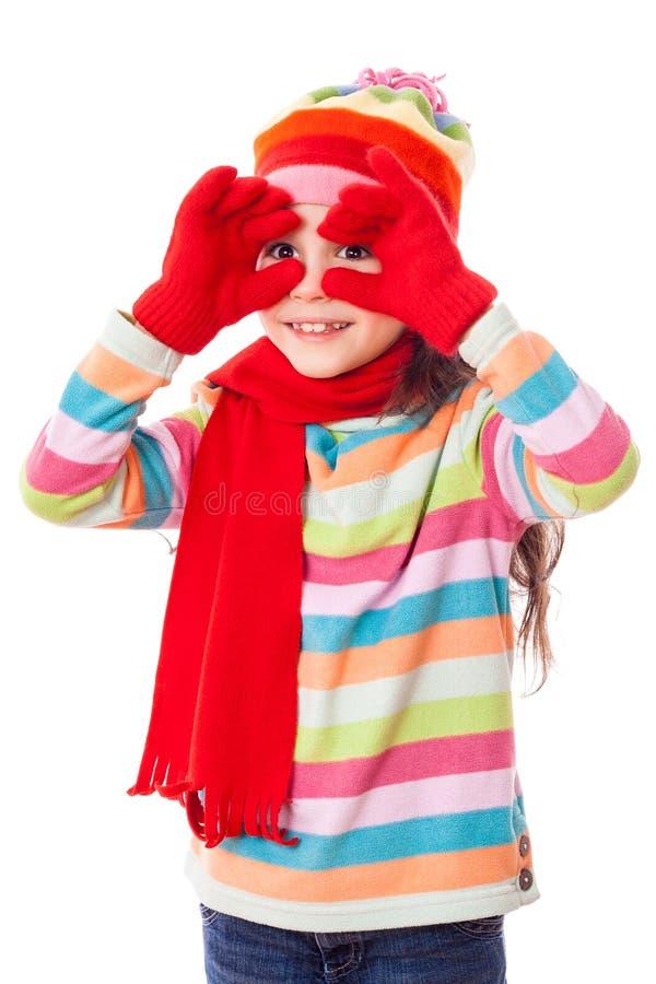 Fille drôle dans des vêtements de l'hiver photographie stock libre de droits