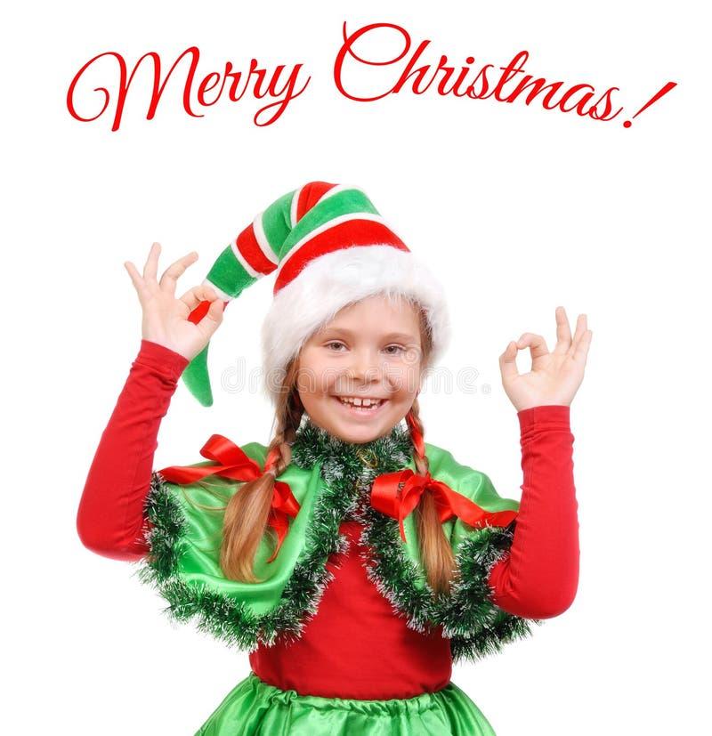 Fille - elfe du ` s de Santa montrant l'OK de signe photographie stock
