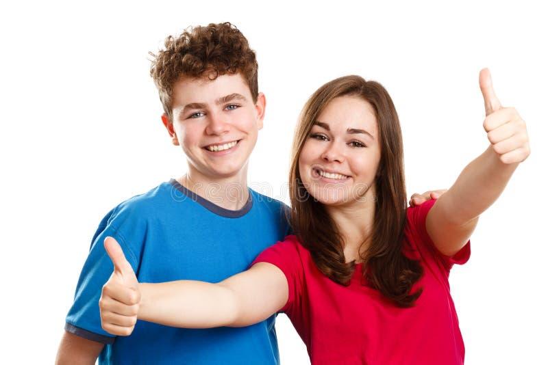 Fille et garçon montrant le signe correct photo stock