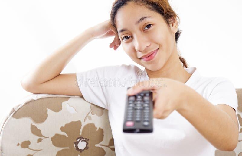 Fille et télévision images stock