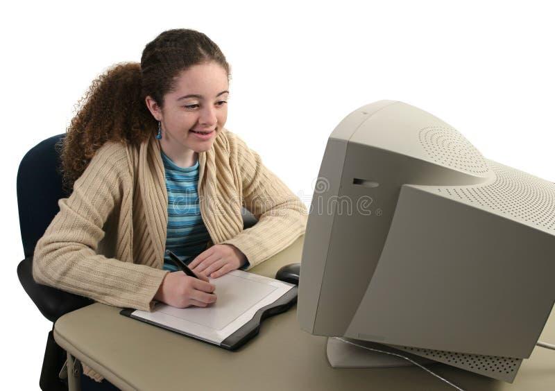 Fille et tablette graphique de l'adolescence image stock