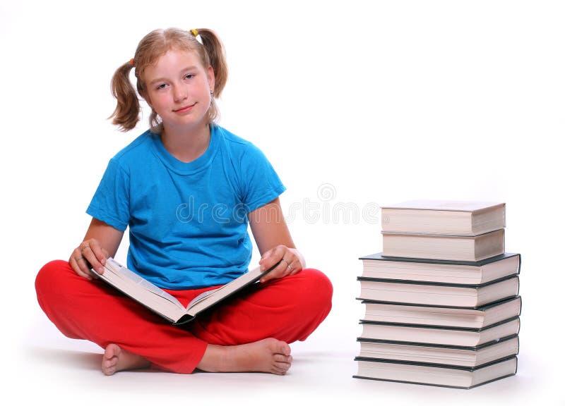 Fille heureuse avec des livres. images libres de droits