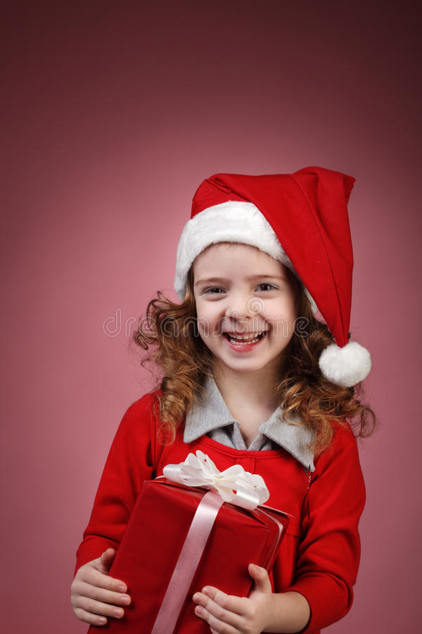 Fille heureuse avec le cadre de cadeau photo libre de droits