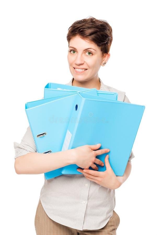 Fille heureuse avec les dossiers bleus pour des documents sur un blanc images libres de droits