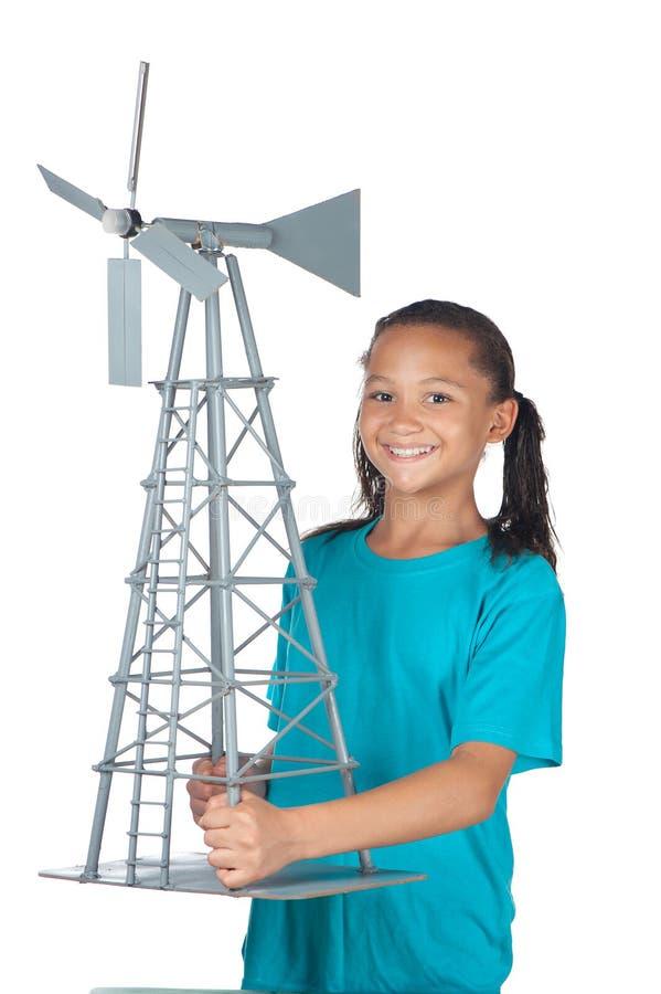 Fille heureuse d'école avec le moulin à vent photos stock