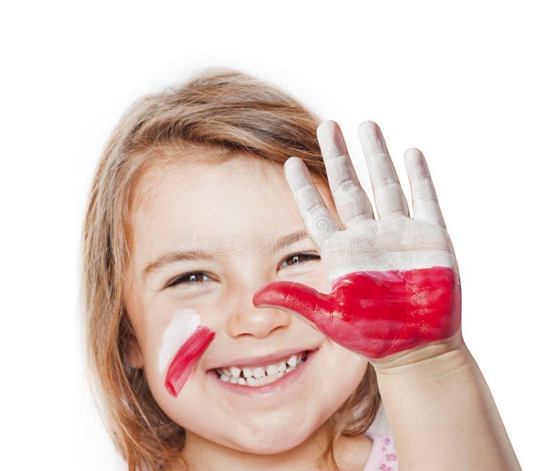 Fille heureuse de ventilateur avec les mains peintes image stock