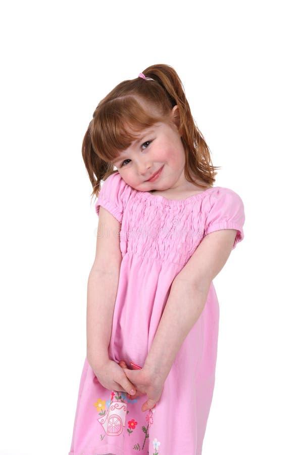 Fille heureuse et mignonne dans le rose photos libres de droits