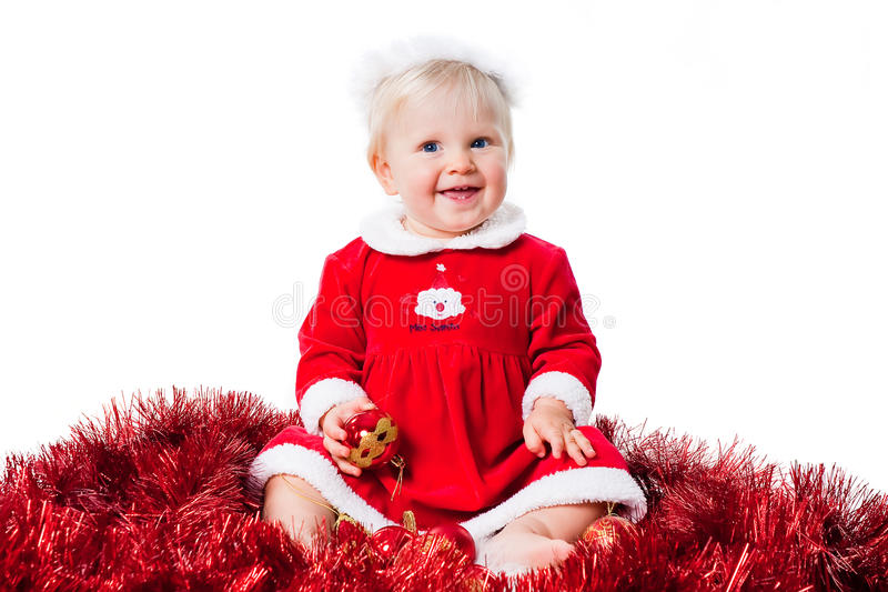 Fille infantile heureuse s'usant le procès de Santa d'isolement photographie stock