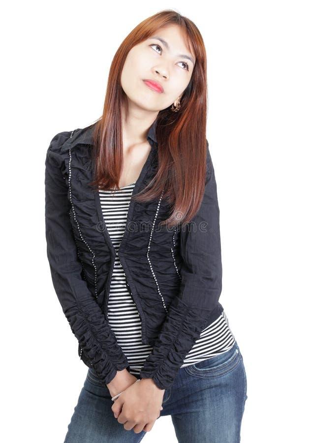 Fille japonaise grande dans des jeans photo stock