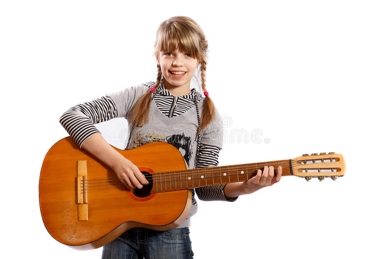 Fille jouant la guitare photos stock