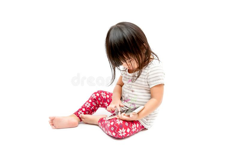 Fille jouant le téléphone photographie stock