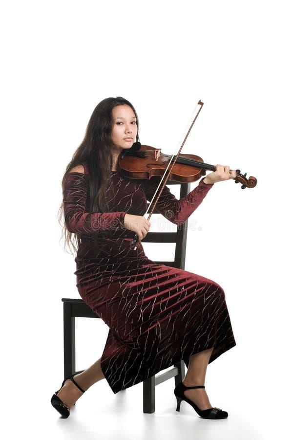 Fille jouant le violon images stock