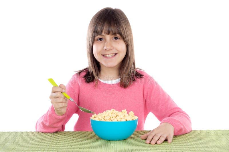 Fille mangeant de la céréale images libres de droits