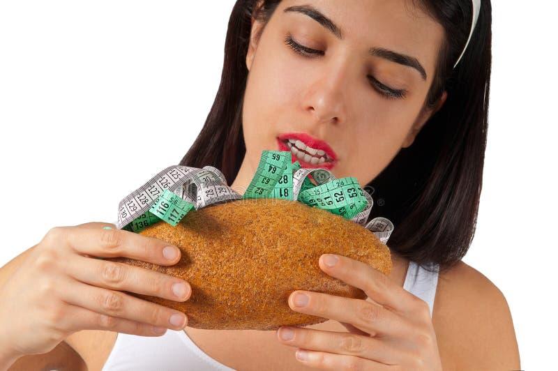 Fille mangeant le sandwich léger - régime photographie stock