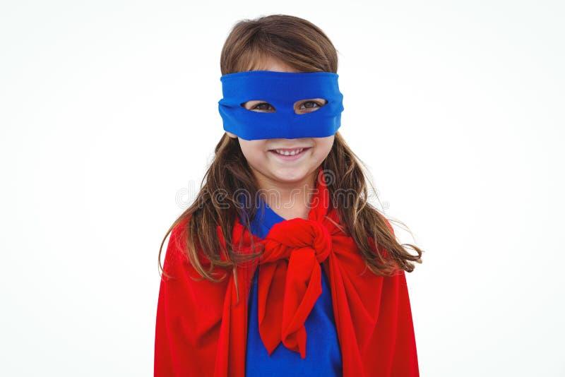 Fille masquée feignant pour être super héros photos stock