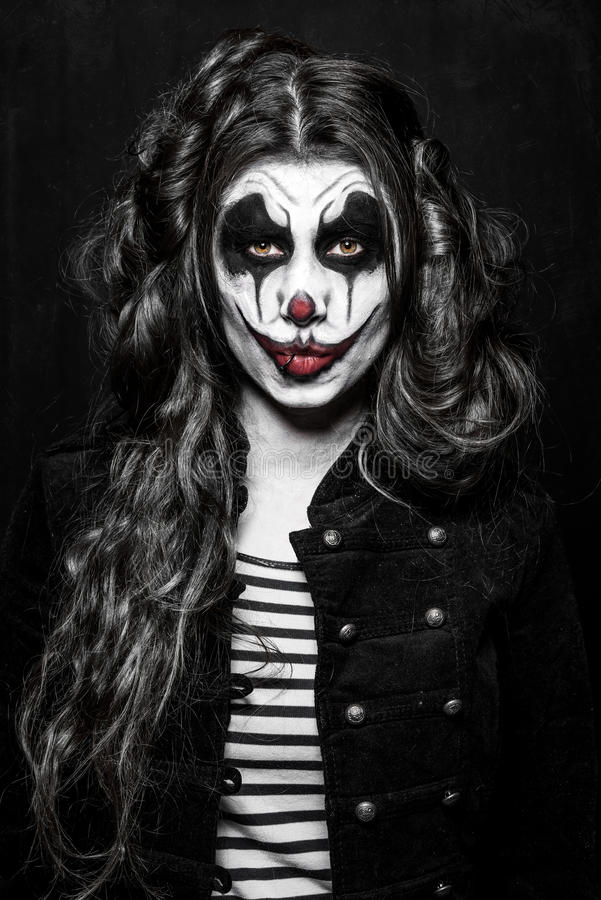 Fille mauvaise effrayante de clown photo stock