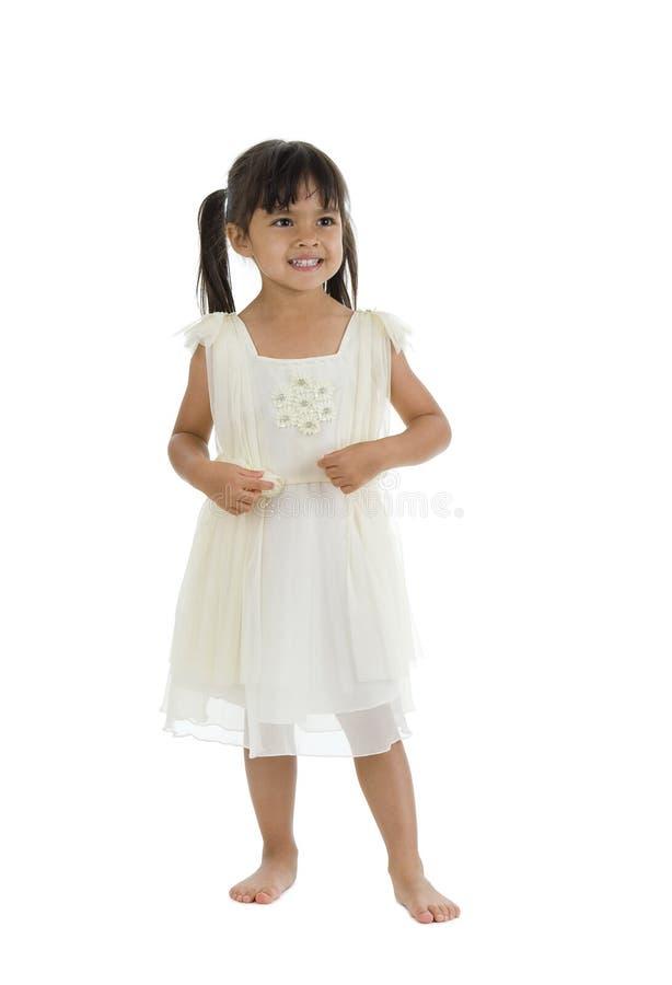Fille mignonne avec la robe intéressante sur le blanc photo libre de droits