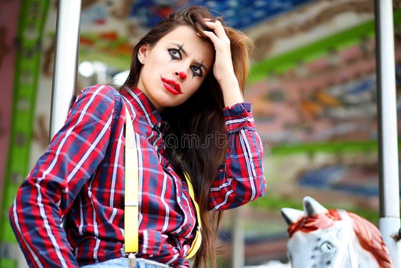Fille mignonne dans un maquillage de clown photographie stock libre de droits