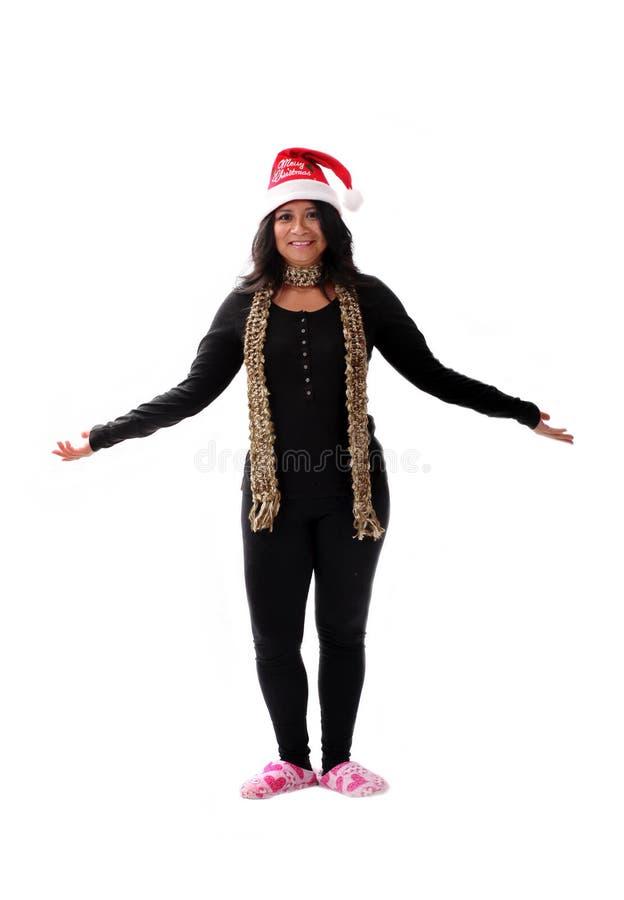 Fille mignonne de Latina dans un chapeau de Santa photographie stock libre de droits