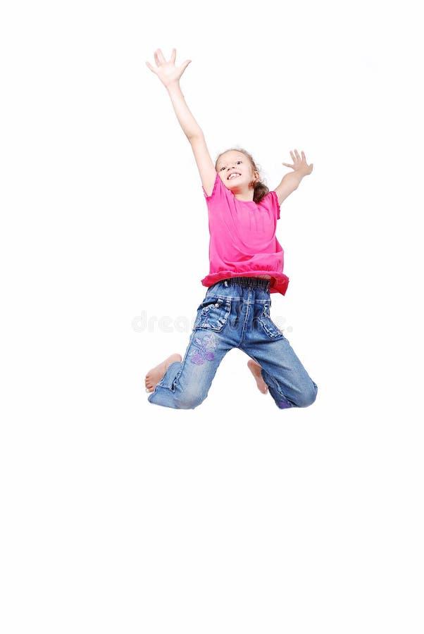 Fille mignonne heureuse dans des vêtements blancs images stock