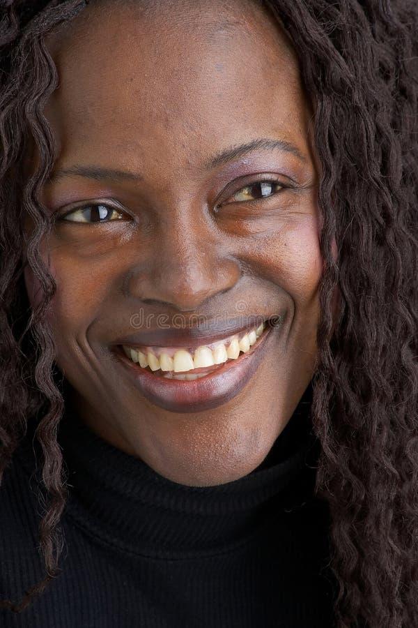 Fille noire de sourire images libres de droits
