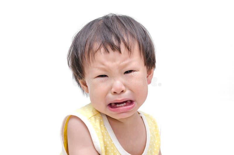 Fille pleurant au-dessus du fond blanc photographie stock
