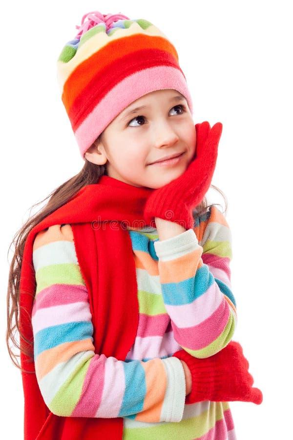 Fille rêvante dans des vêtements d'hiver image stock