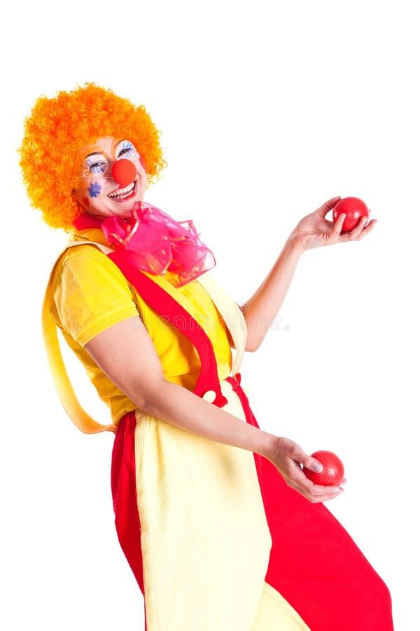 Fille rectifiée en tant que clown jonglant image stock