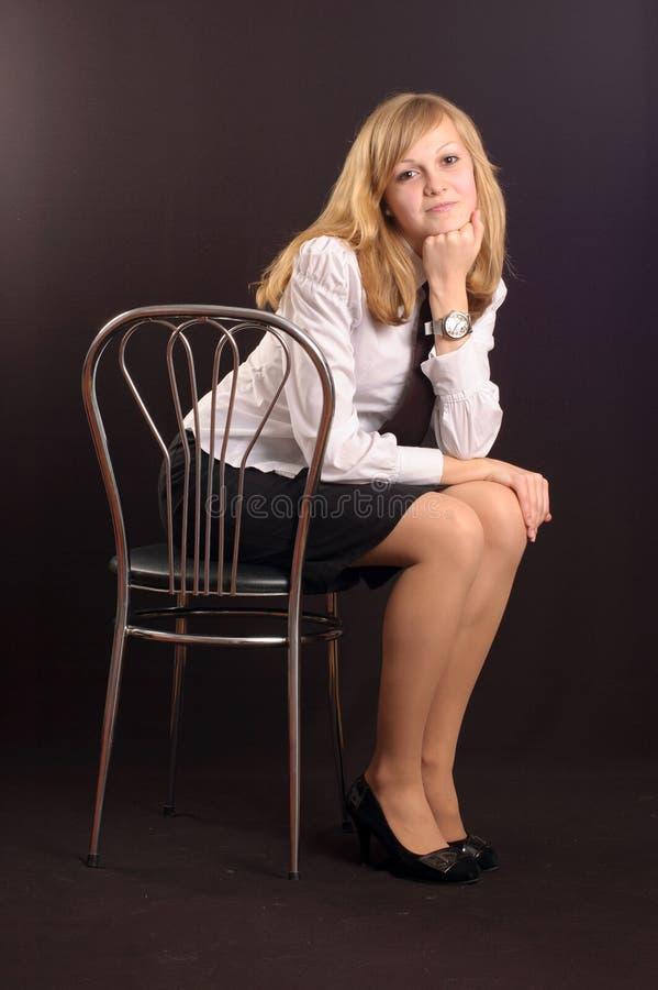 Fille rectifiée en tant que dame d'affaires photographie stock libre de droits