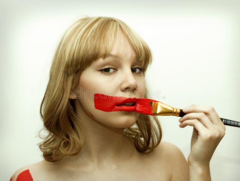 Fille rouge de languettes photo stock
