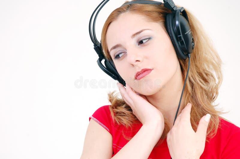 Fille sensible avec l'écouteur images stock
