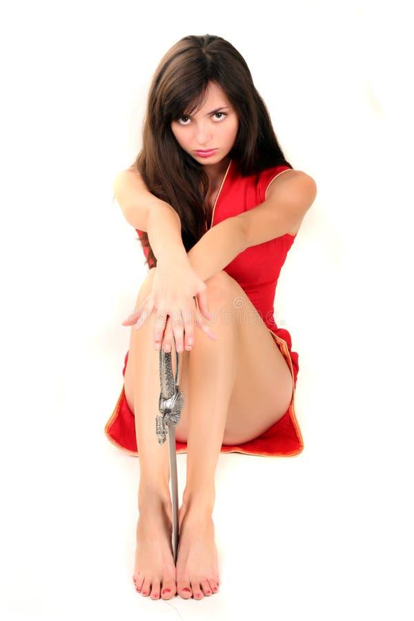 Fille sexuelle avec l'épée photo stock