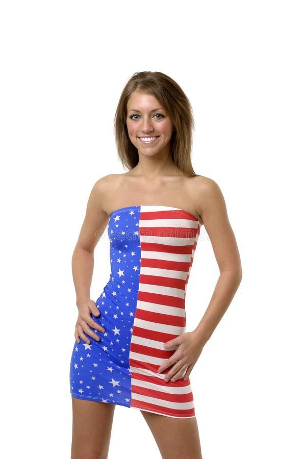 Fille sexy dans la robe d'indicateur américain photos stock