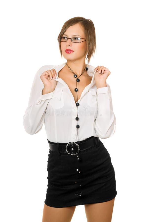 Fille sexy dans une jupe noire et une chemise blanche photos libres de droits